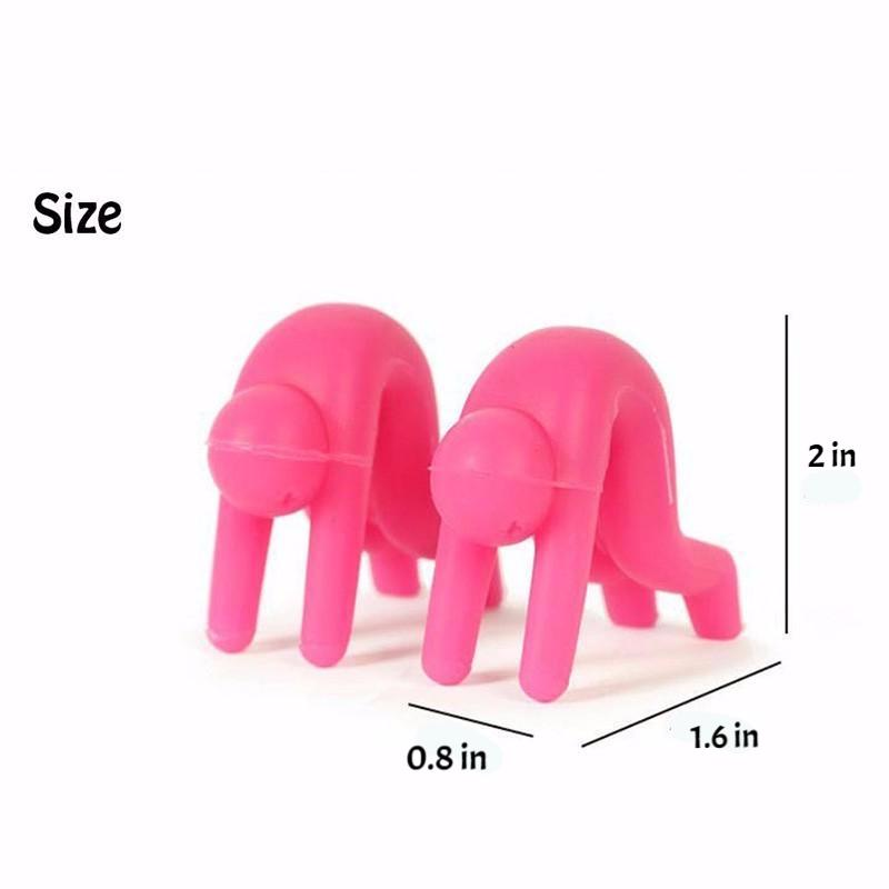 Pink silicon little people - kitchen fun - measuring 0.8 inches wide by 2 inches high