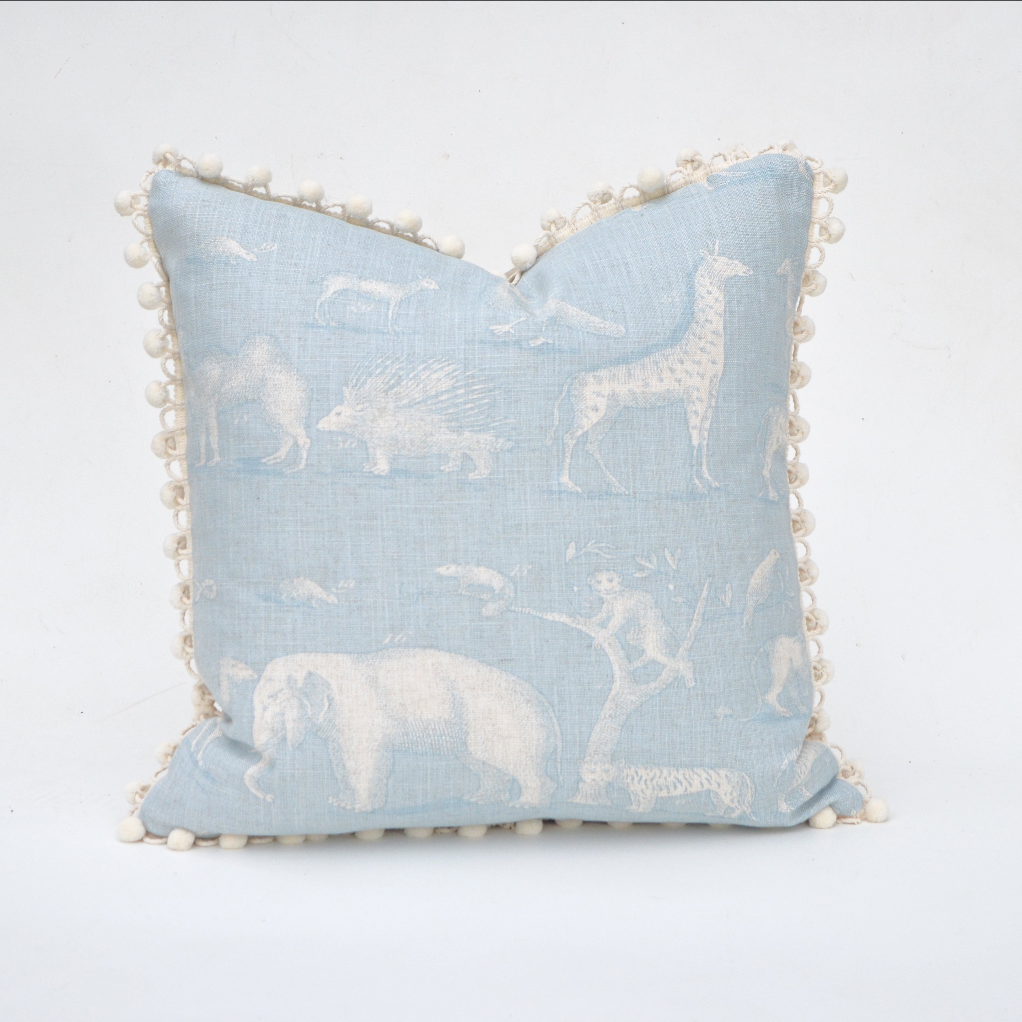 Elizabeth Andersen's Animal Kingdom Pillow Covers come from an Andrew Martin fabric design for Kravet Couture. The fun, whimsical fabric print design features animals from elephants to monkeys, camels to porcupines, all created in a fanciful vintage style