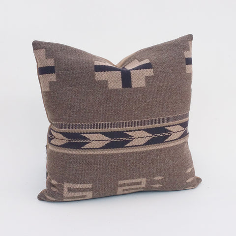 he classic pattern and textured wool of Ralph Lauren Home's Dancing Arrows Trading Blanket fabric make the perfect decorative pillow that is rich, plush and timeless. The neutral colors and native geometric pattern compliment decor from rustic to traditional. Each pillow cover is individually hand-crafted with great attention to detail. Our trading blanket pillow cover is backed with a luxuriously soft faux leather in your choice of either aged tan or distressed dark brown.