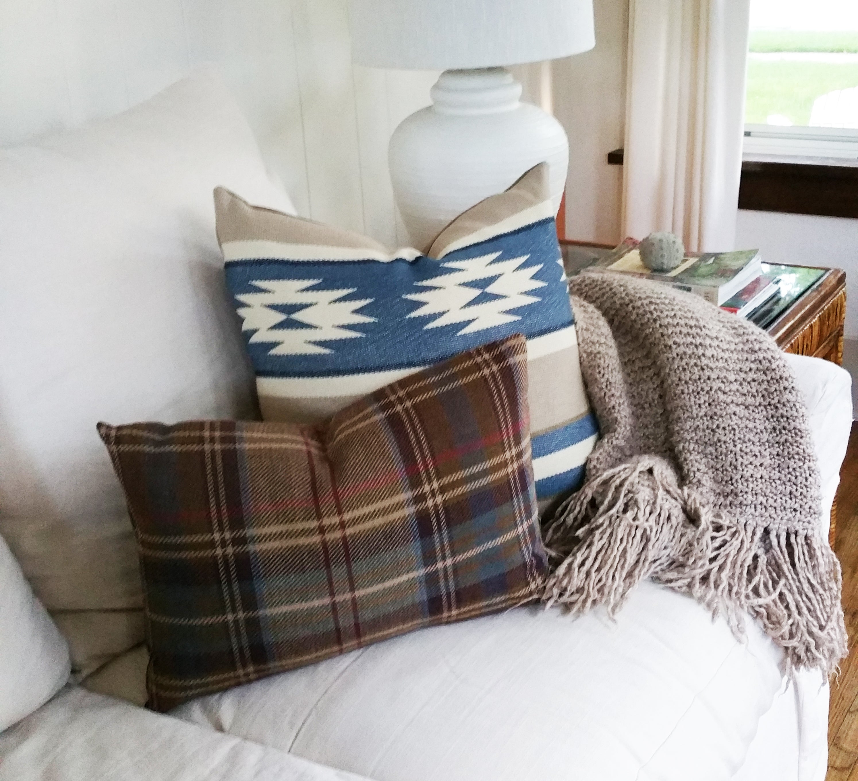 Custom pillow covers made from Ralph Lauren Home fabrics are always a great way to make a statement with your home decor.