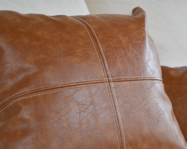 Elizabeth Andersen hand makes each of these simple, classic faux leather with a beautiful top-stitch detail. Each cover is handcrafted from a beautiful faux leather with a varied grain and color giving it a great authentic appearance. The panels look great at nearly any size which makes this handsome pillow cover one of our favorites.