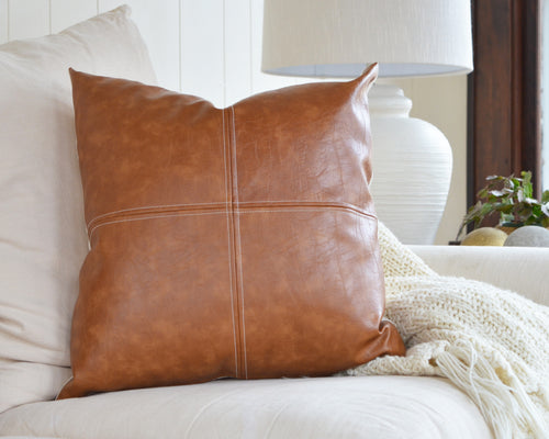 Simple, classic faux leather with a beautiful top-stitch detail make this handsome pillow cover one of our favorites. Each cover is handcrafted from a beautiful faux leather with a varied grain and color giving it a great authentic appearance. The panels look great at nearly any size.
