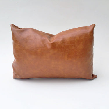 This is Elizabeth Andersen's classic pillow cover, caramel faux leather adds great texture and a warmth to any space in which it's used. It perfectly transcends all styles and works from living areas to bedrooms to accent chairs or as large floor pillows. Available in virtually any size. Custom sizing, quantity and yardage inquiries welcome.