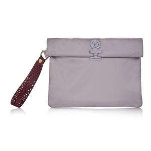 La Pochette waterproof wristlet for use with No Excuses large and small kit bag with metal button fastening.