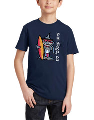 Boys youth T-Shirt in Navy Blue. Graphic Design by local San Diego, California Artist. Graphic tee features a rad cool hip shark, wearing summer shades and holding a bright orange red surf board. Very colorful design for children. Sizes Small through X-large. Sold by San Diego Trading Co.