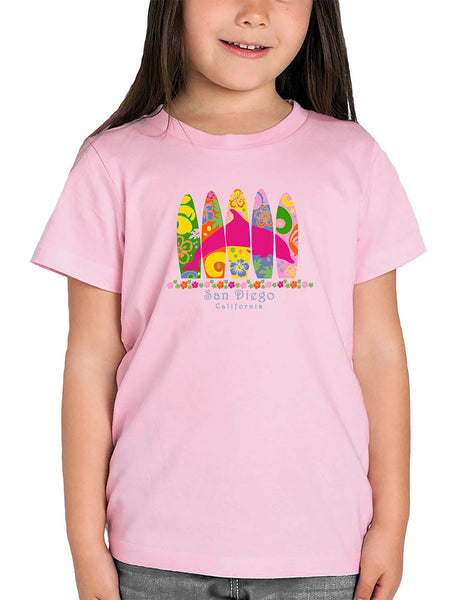 Girl crewneck t-shirt dolphin and surfing board design. Great gift for youth girls. Cool and Trendy design. Make an outfit for everyday wear, by local San Diego, California Artist. Design, Printed, and Sold by San Diego Trading Co.