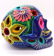 Sugar Skulls ceramic clay painted with traditional Mexican art. Navy with multicolor detailed around flower latten carving. Dad of the Dead Catrina. Dia de los Muertos. Skulls decoration.