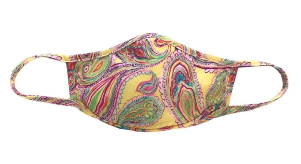 Face mask paisley colorful red, green, blue pattern on a pale yellow solid background. Men or Women unisex one size fits most protective mask.