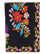 Front of Black Hard cover notebook with a colorful Mexican embroidered flower design on cloth wrapped with 120 blank pages