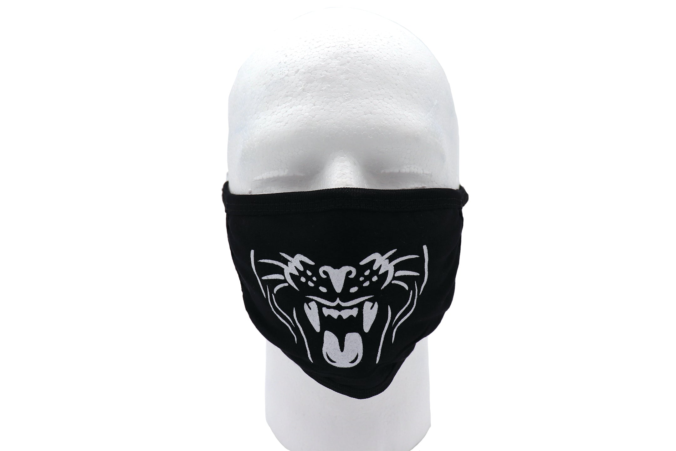 Black face mask, jaguar face mask, cat face mask, fierce face mask. Black face mask cotton material with printed white jaguar face open with teeth and tong showing. Mandibular face of jaguar cat print on black face mask.