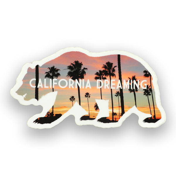 California sticker of bear with palms trees. California Republic bear outline with sunset background and shadow palm trees in the background and California Dreaming in caps wording. Awesome cali stickers. Best California Stickers. Sold by SDTrading Co.