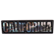 Black rectangular magnet with the word California cut out featuring the San Francisco bridge the Hollywood sign and a beach wave