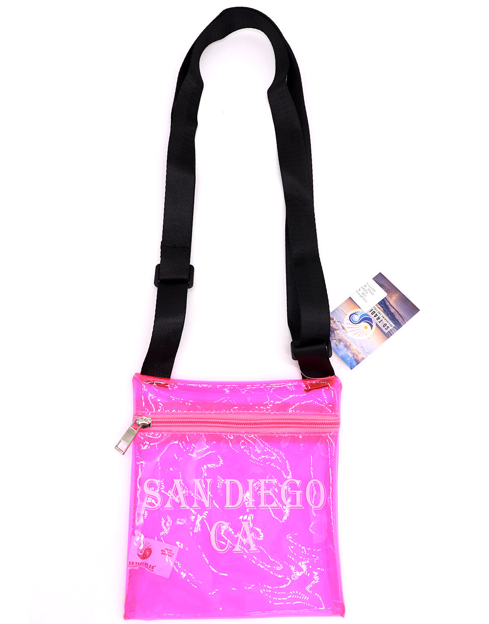 Passport Bag for passport, documents and money. This bag is clear neon fuchsia pink with black cross body strap that is adjustable and printed front with San Diego, CA block letters. Fun, functional, versatile and ready for upcoming vacation travel.