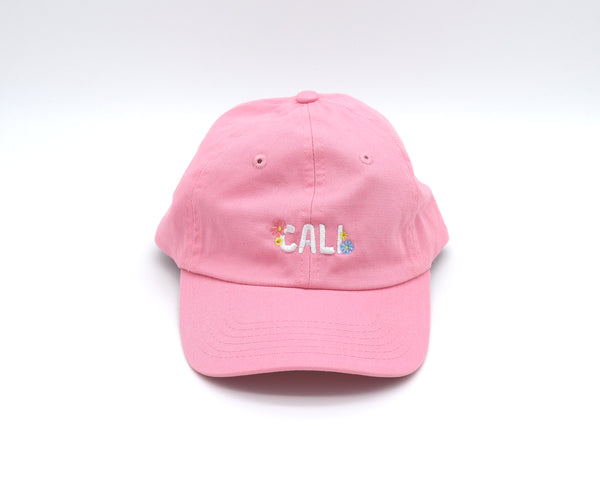 Solid Light Pink youth adjustable cap with verbiage Cali surrounded by two daisy flowers on each side