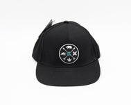 Solid black 5 panel snap back hat with a high frequency black patch outlined with silver paint and silver icons of cross arrows with a bear, wave, surfboards, and cannabis leaf on each opening and the letter CA in blue on the center