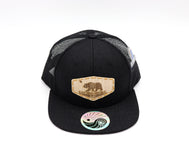 Solid Black Trucker hat with flat bill and California Republic Flag wood emblem on the center front