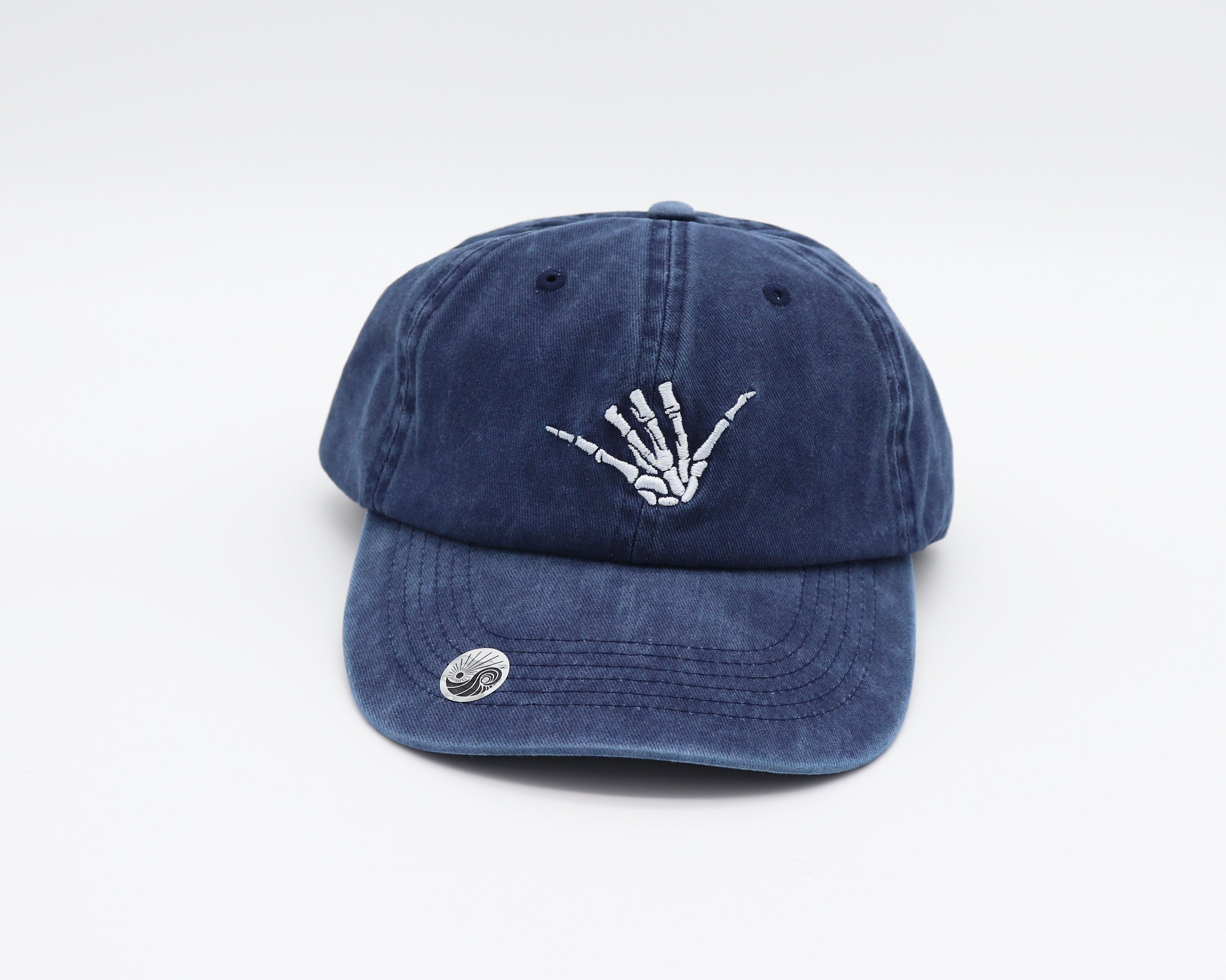 Faded Navy dad hat with a skeleton shaka hand embroidered in white on the center front