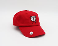 Solid red unstructured adjustable hat with a white embroidered circle mimicking Thing 1 but with devil horns and a tail and Trouble 1 verbiage in the middle