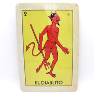 El Diablito loteria card stamped on a metal sheet frame in full color in its packaging a perfect home decor gift for anyone
