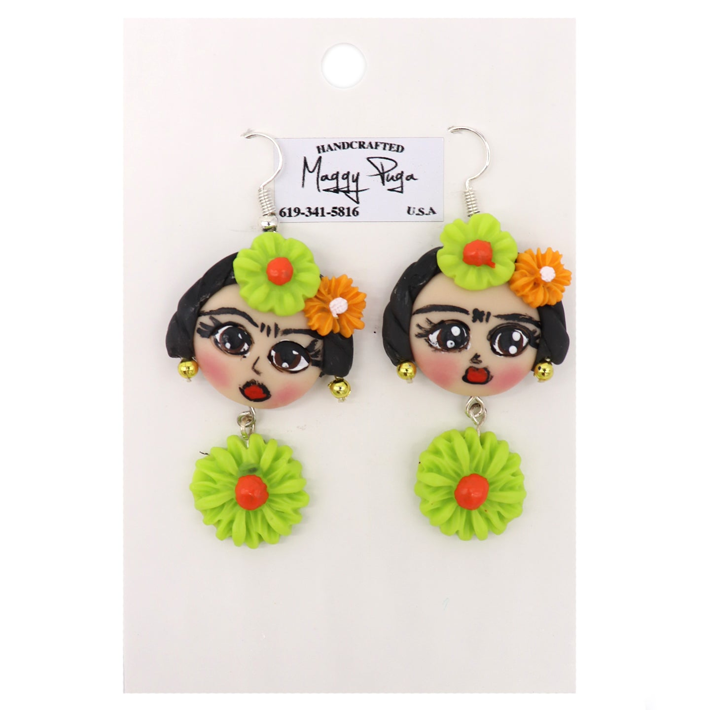 Handcrafted Women Earrings featuring Frida Kahlo with her dark hair, flowers, and gold earrings, and a hanging flower. Handmade with love by small shop Maggy Puga and Sold by SDTrading Co.