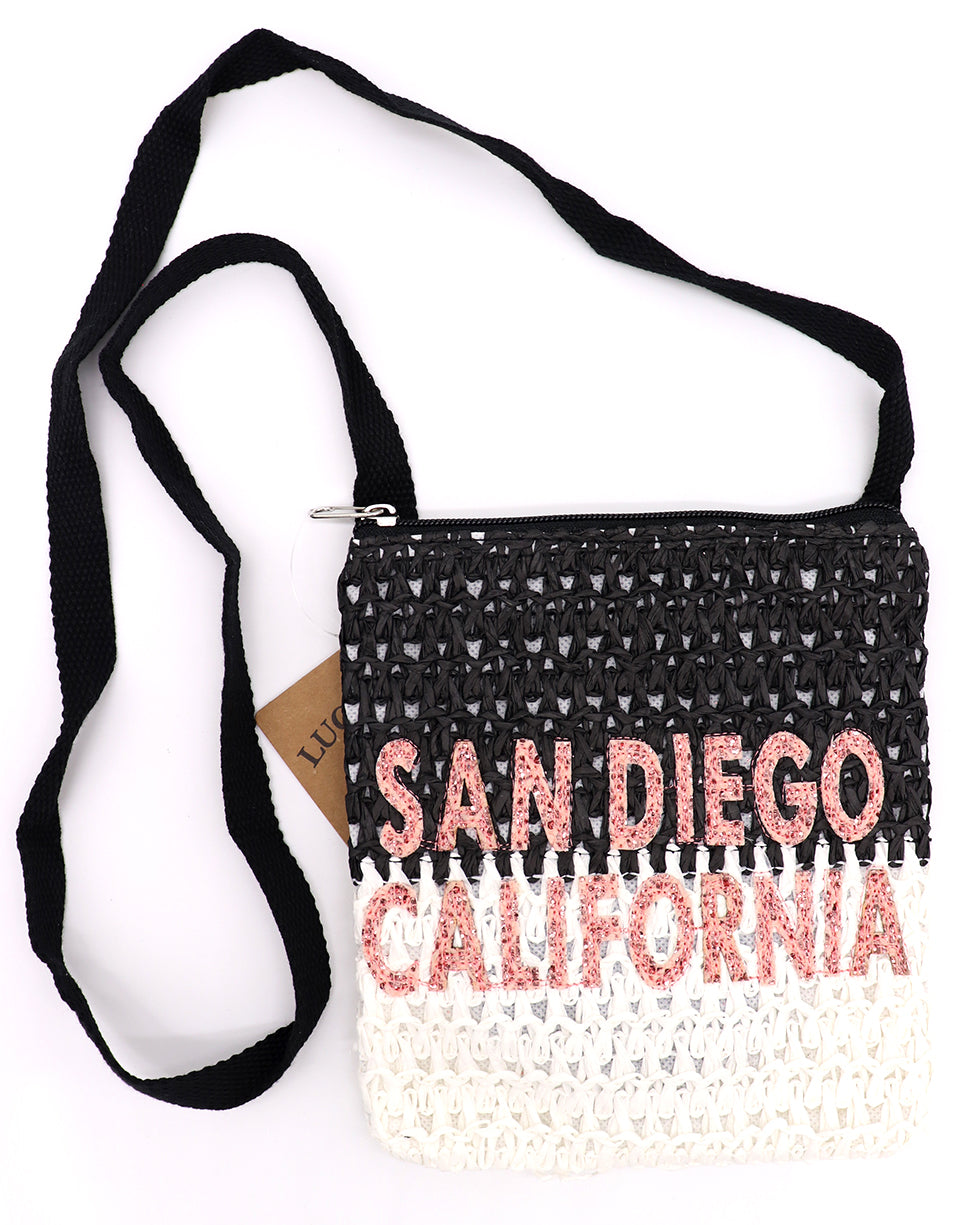 San Diego California passport cross body bag in waved crotchet pattern in two tone black top and white bottom, and long cross body black strap. Glitter pink sparkly letters. Lucky 7 brand. Sold by SDTrading Co.