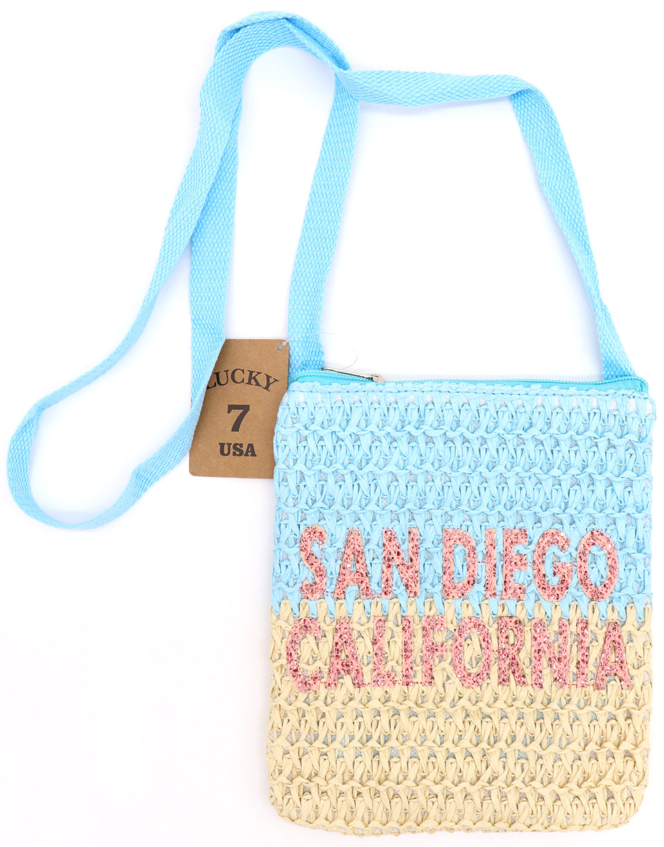 San Diego California passport cross body bag in waved crotchet pattern in two tone blue top and khaki bottom, and long cross body black strap. Glitter pink sparkly letters. Lucky 7 brand. Sold by SDTrading Co.