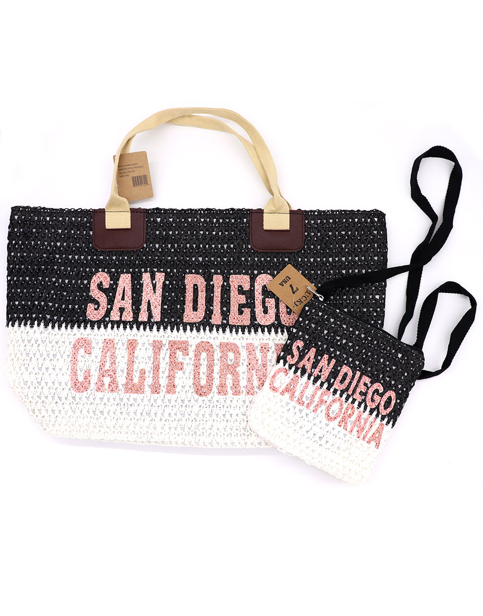 Large tote bag in two tone colors with brown trap. Top half is black, bottom white, with San Diego, California in light pink sparkle glitter in the middle. Passport cross body bag pictured, matching large tote bag. Each sold separately by SDTrading Co.