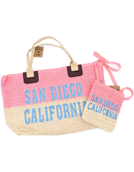 Large tote bag in two tone colors with brown trap. Top half is pink, bottom khaki, with San Diego, California in seafoam teal sparkle glitter letters centered in the middle. Passport cross body bag pictured, matching large tote bag. Each sold separately by SDTrading Co.