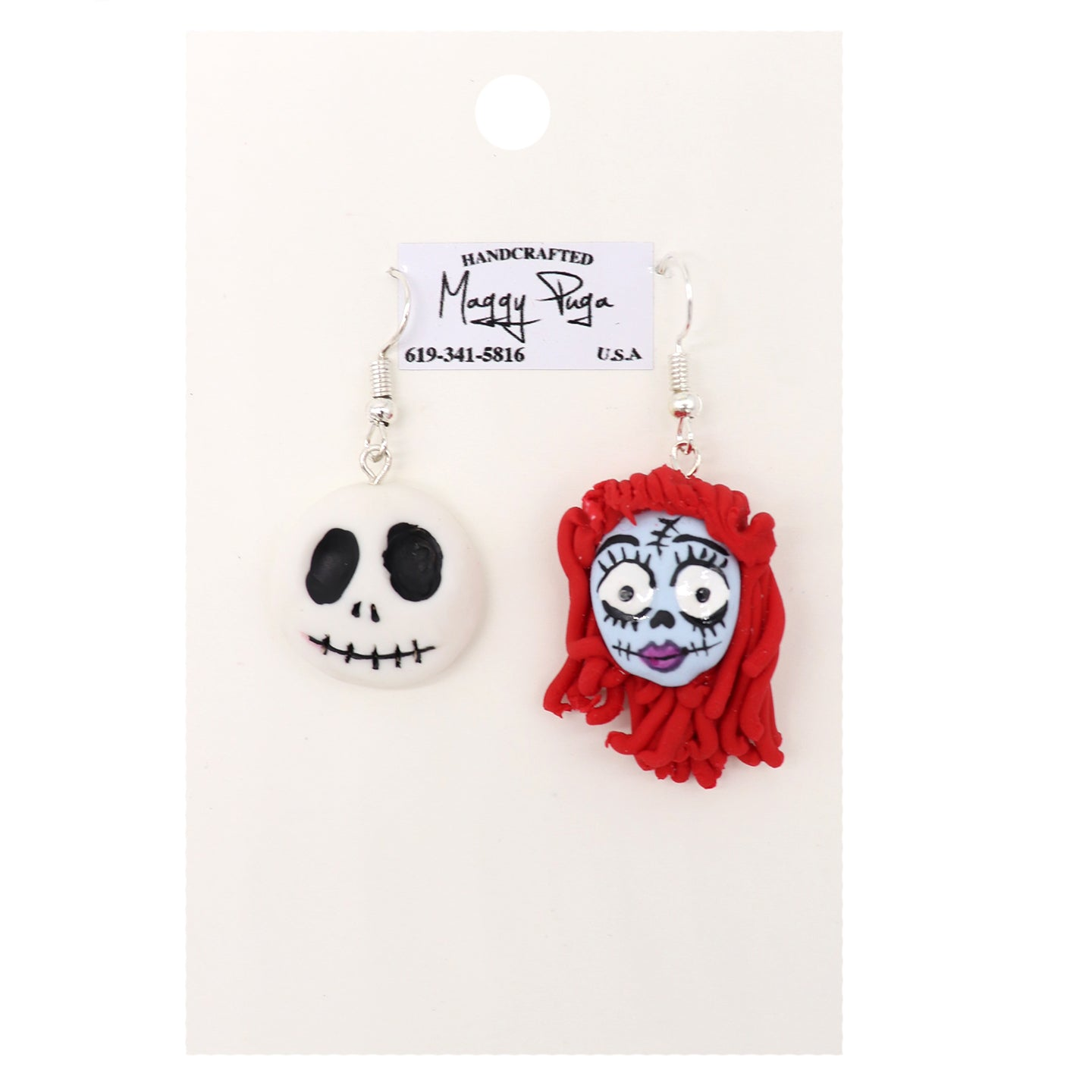 Jack and Sally Earrings. Holiday gifts for Christmas. Handcrafted white skull with black features. Blue skull with red hair. Handmade by small shop Maggy Puga and Sold by SDTrading Co.