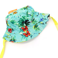 Kids bucket hat with built in UV protection, UPF 50+ for infants, toddler, and small children. Built in sun protection. Lightweight hat for sunny days, beach, pool, zoo, and playdates. Teal hat features tropical foliage and orange butterflies with yellow straps.