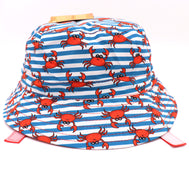 Kids bucket hat with built in UV protection, UPF 50+ for infants, toddler, and small children. Built in sun protection. Lightweight hat for sunny days, beach, pool, zoo, and playdates. Stripes blue, white features red crabs and red straps. Reverses to solid red hat.