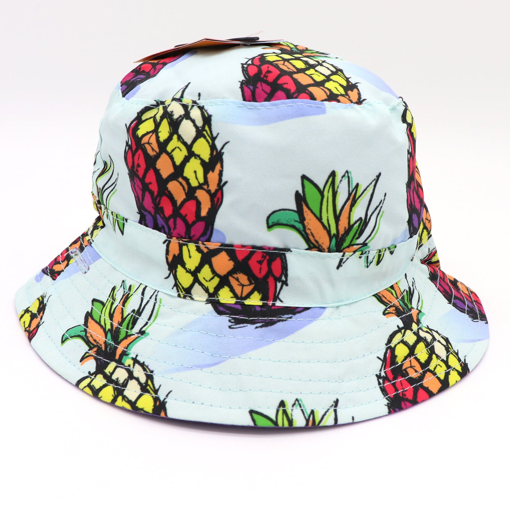 Kids bucket hat with UV protection, UPF 50+ for infants, toddlers, and small children. Sun protection. Lightweight hat for sunny days, beach, pool, zoo, and playdates. Soft blue with rainbow pineapples, and purple Velcro straps. Reverses to solid lilac hat. Sold by SDTrading Co.