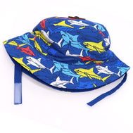 Kids bucket hat with built in UV protection, UPF 50+ for infants, toddler, and small children. Built in sun protection. Lightweight hat for sunny days, beach, pool, zoo, and playdates. Navy blue hat featuring colorful sharks in different solid colors (red, yellow, grey, and blue). With matching navy Velcro straps. Reverses to solid Navy hat.