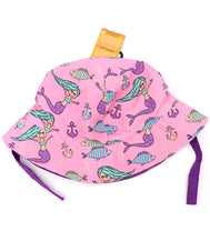 Girl's mermaid water hat, wound panel bucket hat with built in UV protection, UPF 50+ for infants, toddler, and small children. Lightweight hat for sunny days, beach, pool, zoo, and playdates. Pink hat features mermaids, anchors, and fish with purple Velcro straps. Reverses to solid purple hat.