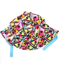 Kids bucket hat with built in UV protection, UPF 50+ for infants, toddler, and small children. Built in sun protection. Lightweight hat for sunny days, beach, pool, zoo, and playdates. Colorful orange, yellow hat with geometric triangles and palm tree silhouettes with baby blue Velcro straps. Reverses to solid baby blue hat.