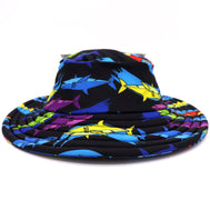 black spandex & polyester beach bucket hat with a colorful shark pattern. Large brim and UV protection factor to keep them safe from the sun. Ideal for water activites : pool, lake, ocean, beach, waterpark. For small children, infants, toddlers, and kids. Sold by SDTrading Co.