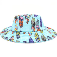 Kids blue bucket hat with a surfboard pattern all around