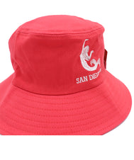 Front view of Coral kids bucket hat featuring an embroidered design of a mermaid with verbiage San Diego, Ca in white below it