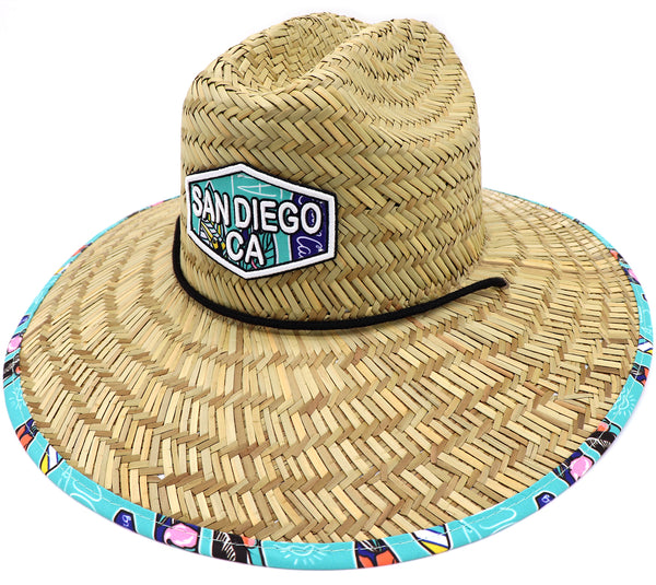Adult lifeguard straw hat with San Diego, California front patch. Wide straw brim. Featuring surf boards on an aqua blue background with many uniquely design surf boards, fish, and boats. Great men's vacation hat or women' beach hat vibes. Adjustable draw cord string. Sold by SDTrading Co