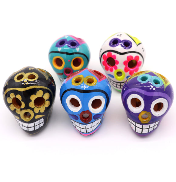 Sugar Skulls are handcrafted and hand painted with unique colorful features from Mexico. They come in sets of five, painted differently. Some come in black and gold, blue tones, purple tones, teal tones ,and even a white with colorful painted features such as flowers.