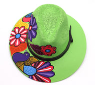Adult hat uniquely hand painted by local mexican artist. Sombrero hat are comfortable and offer nice shade for summer heat protection and keeping cool. Great cultural piece or gift for a loved one. Each design is unique. Neon Green color Hat with dark brown strap, and flowers and birds design.