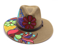Adult hat uniquely hand painted by local mexican artist. Sombrero hat are comfortable and offer nice shade for summer heat protection and keeping cool. Great cultural piece or gift for a loved one. Each design is unique. Khaki Hat with dark brown strap, and flowers and birds design.