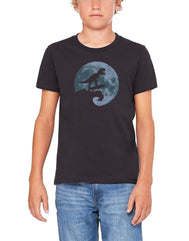 Boys or Girls unisex graphic dark gray  surfing dinosaur t-shirt. Features Dinosaur silhouette surfing a wave in front of a full moon. Great for back to school, summer, and everyday wear for youth. Cool laid back Cali Graphic Design by local San Diego, California Artist. Design, Printed, and Sold by San Diego Trading Co.