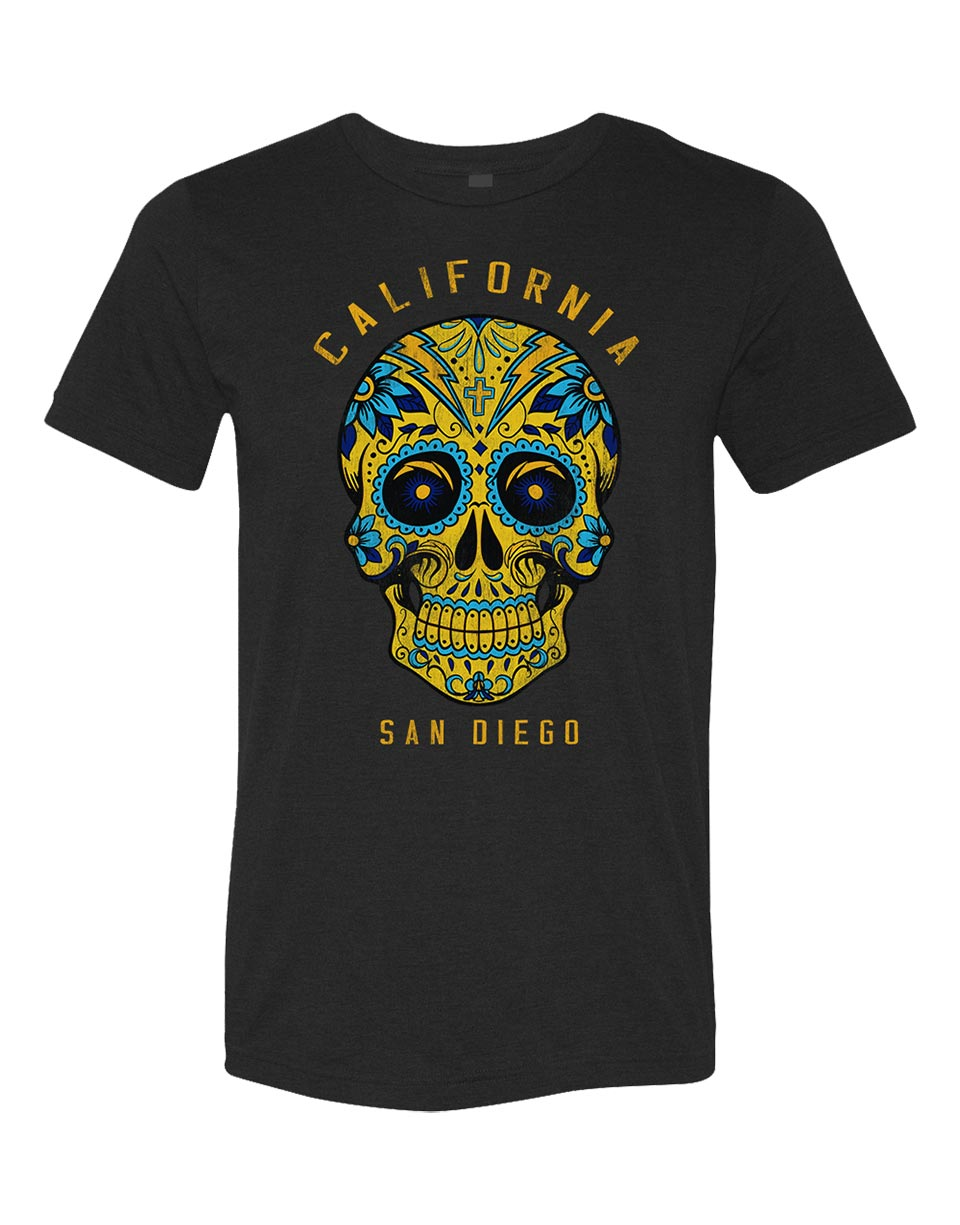 Mens charcoal heather short-sleeve t-shirt featuring colorful blue and yellow Chargers colored Mexican sugar skull with cross