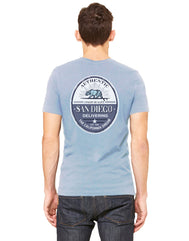 Adult sky blue shortsleeve shirt with left chest design with verbiage San Diego Delivering the California Dream and  a bear riding a surfboard