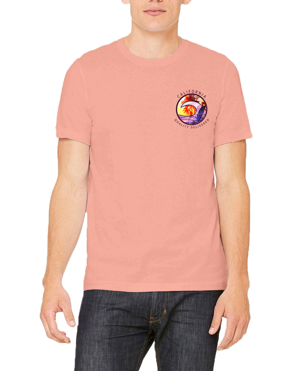 model in Solid Pastel Pink men's tshirt with California Quality Delivered verbiage around a circle with a wave and palm tree infused graphic