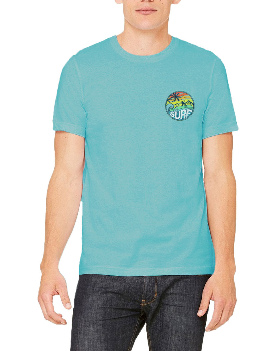 Model in Adult solid aqua short sleeve shirt with surf on a left chest circle beach and mountains scene in Red orange yellow green aqua lines