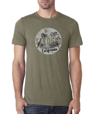 Adult heather olive short sleeve shirt with est 1850 San Diego California Sun Surf Ocean in a distressed circle   print of ocean surfboard and palm tree scene