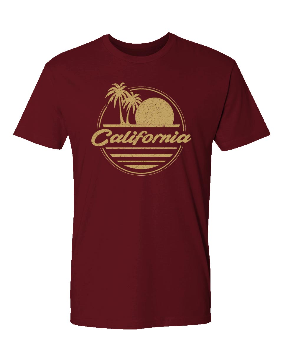 Men's maroon red short-sleeve t-shirt with circular distressed sunset and palm tree beach waves print and California verbiage