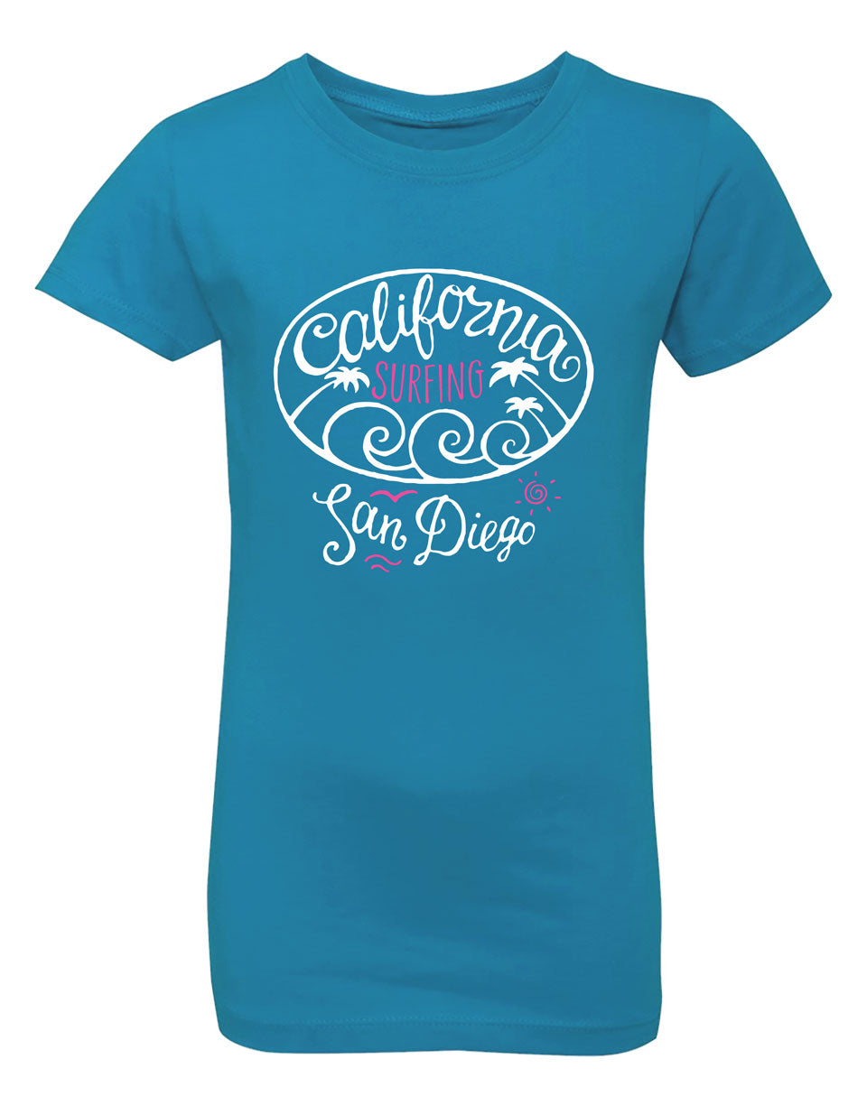 Girls surfing California, SD turquoise graphic t-shirt. A nice swirl of waves and palm trees. Great for beach, back to school, summer, and everyday wear for youth. Cool laid back Cali Graphic Design by local San Diego, California Artist. Design, Printed, and Sold by San Diego Trading Co.